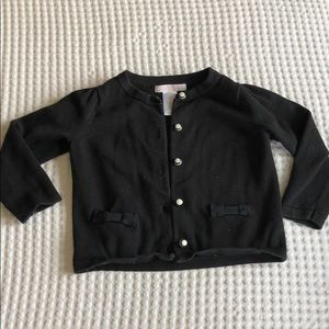 Black sweater with bow pocket details